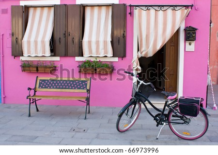 Colorful house on the island of Burano - stock photo