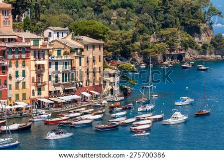 Colorful houses and boats in Portofino - famous village on Italian Riviera. - stock photo