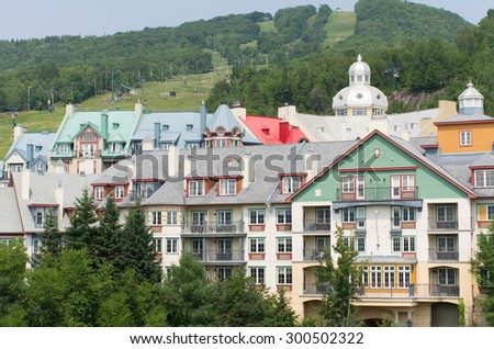 Colorful houses at Mont Tremblant in summer - stock photo