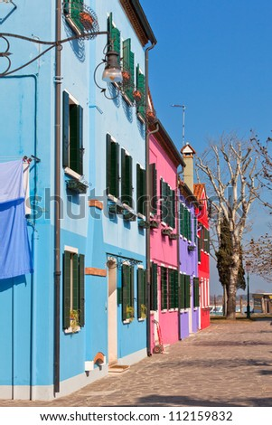 Colorful houses in the island of Burano near Venice, Italy - stock photo