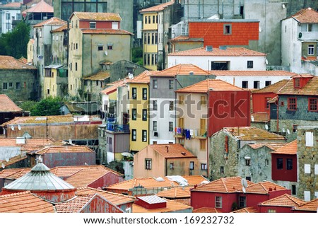 Colorful houses of historical center of Porto, Portugal. It is included in UNESCO World Heritage List and attracts many tourists to the city