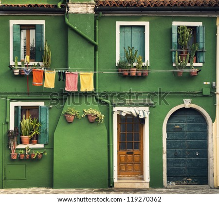 Colorful houses taken on Burano island, Venice, Italy in summer time. - stock photo