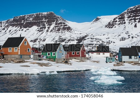 Colorful houses, with mountain in background, Qeqertarsuaq, North Greenland