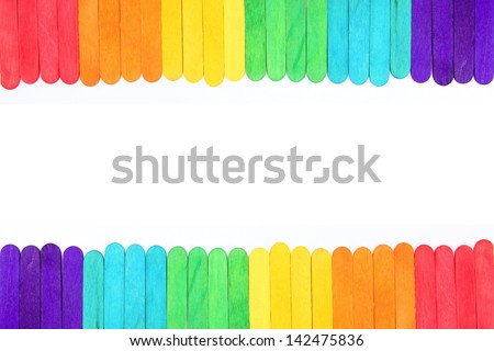 Colorful ice cream sticks as horizontal frame on white background