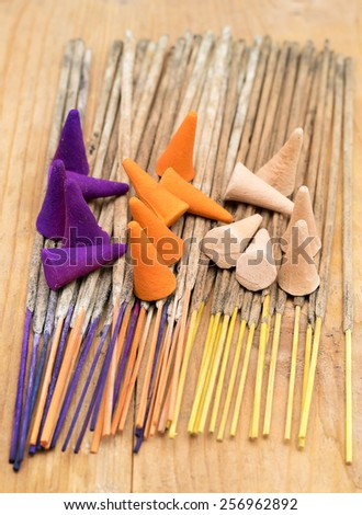 Colorful incense sticks and incense cones - stock photo