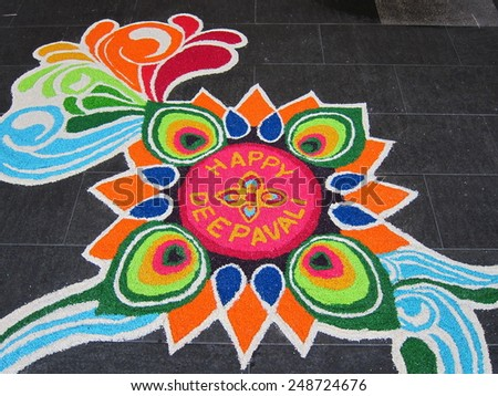 Colorful Indian Festive Decoration on floor - stock photo