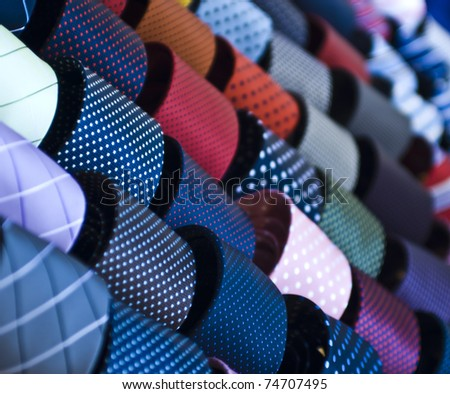 colorful italian ties in soft focus - stock photo