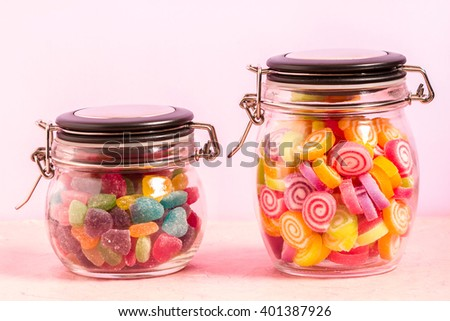 Colorful jellies and candies sweets heart-shaped background - stock photo