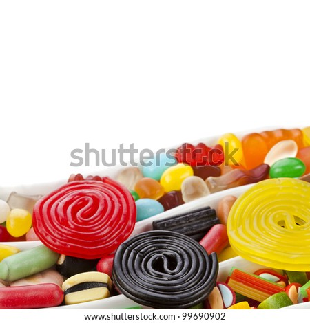 colorful jelly and liquorice candies isolated over white - stock photo
