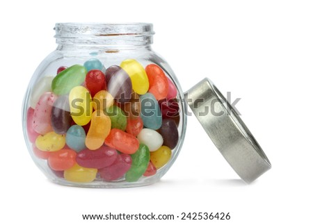Colorful jelly beans in a jar isolated on white. - stock photo