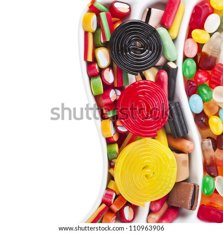 Colorful jelly candies , border over white - stock photo