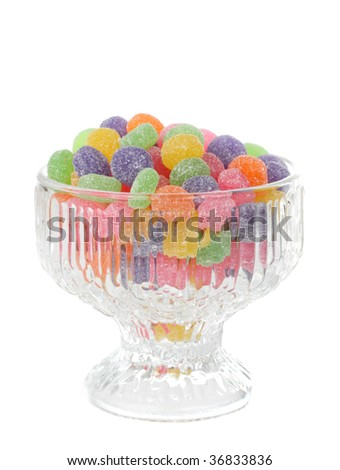 colorful jelly candies in a glass bowl, isolated on white