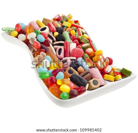 Colorful jelly candies in the dish over white - stock photo