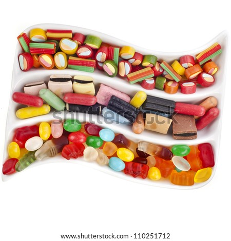 Colorful jelly candies over white - stock photo
