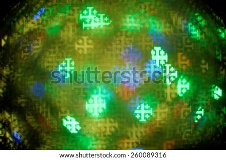 colorful jerusalem cross bokeh background - stock photo