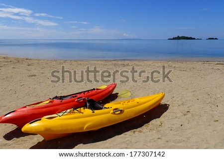 Colorful kayaks on a beach, Vanua Levu island, Fiji, South Pacific
