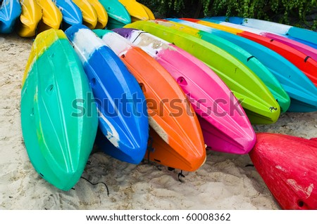colorful Kayaks on the beach - stock photo
