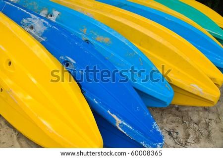 colorful Kayaks on the beach - stock photo