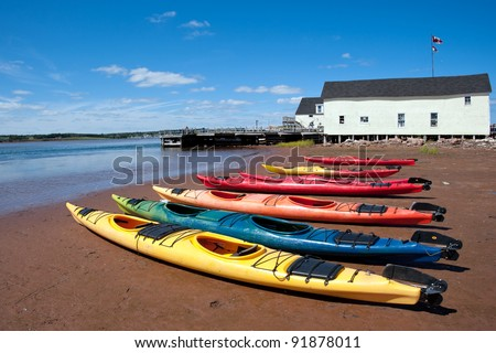 Colorful kayaks on the Prince Edward Island beach - stock photo