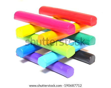 Colorful kid's plasticine on white background - stock photo