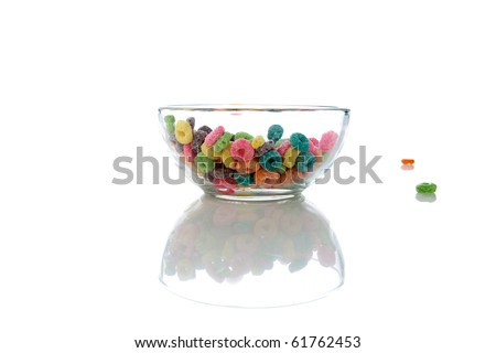 colorful kids breakfast cereal loops with a spoon in fresh cows milk or could be almond milk or even soy milk. isolated on white - stock photo