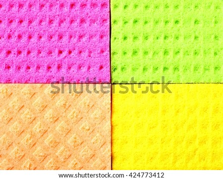 Colorful kitchen sponge rubber foam as background texture. Blocks in different colors. - stock photo