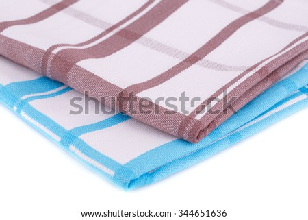 Colorful kitchen towels on white background. - stock photo