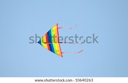 Colorful kite against a clear sky - stock photo