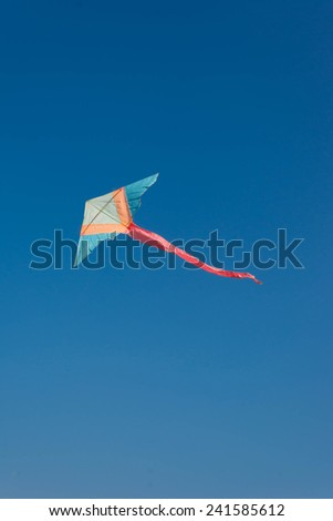 colorful kite on a cloudless sky - stock photo