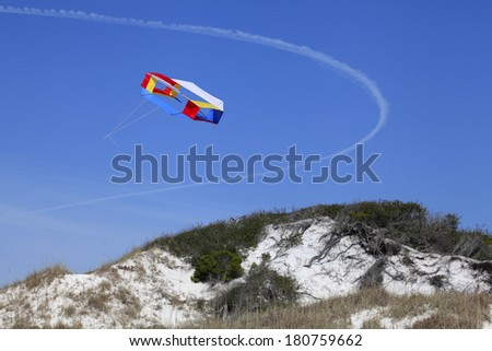 Colorful Kites Flying Over the Sand Dunes - stock photo
