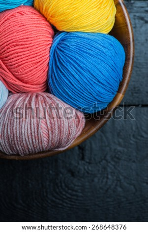 Colorful knitting yarn balls in basket