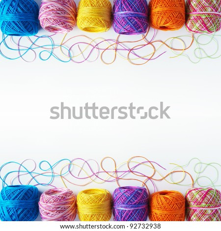 Colorful knitting yarn coils over white background - stock photo