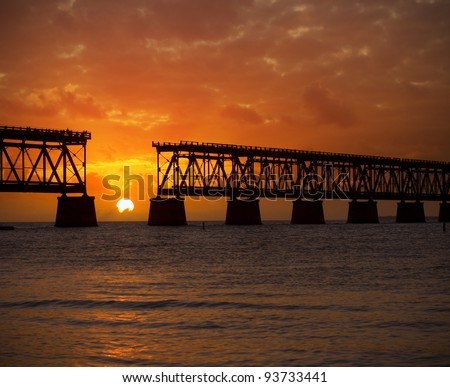 Colorful landscape of a beautiful  tropical sunset or sunrise. Taken at Bahia Honda Key State Park in Florida. Old Flagler Bridge remains as a tourist landmark and a monument to a hurricane. - stock photo
