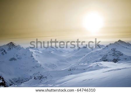 Colorful landscape of snow-covered mountains of the Caucasus - stock photo