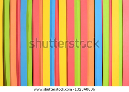 colorful large rubber straps arranged in vertical pattern, horizontal frame.