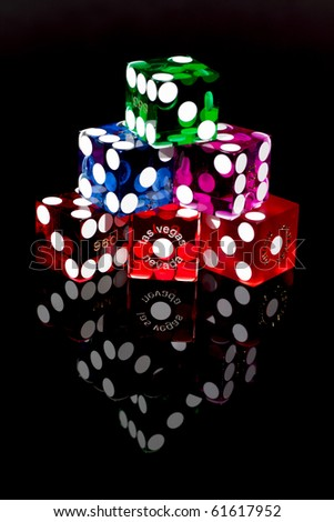 Colorful Las Vegas Craps or Gambling Dice on a black background. - stock photo