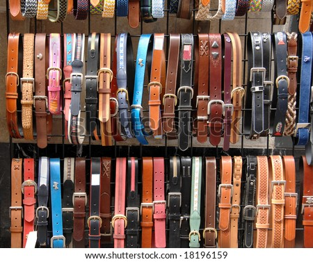 Colorful leather belts in the store - stock photo
