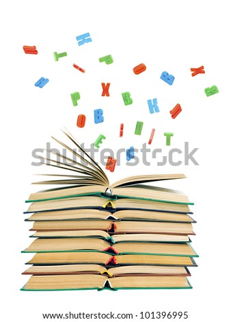 colorful letters flying out of an open book  isolated on white