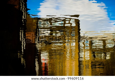 Colorful light reflections on water - stock photo