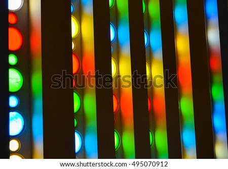 Colorful light streaming through church window. Colorful glass panel for background pattern.