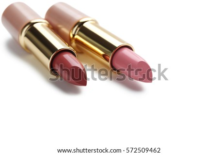 Colorful lipsticks isolated on a white