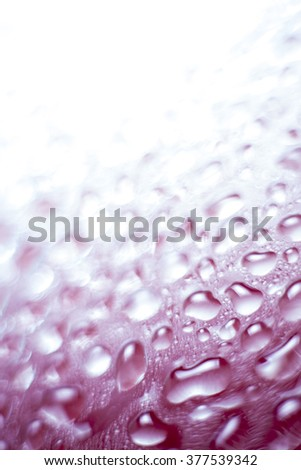 Colorful liquid droplets background wallpaper - stock photo