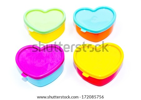 colorful little boxes in the shape of hearts - stock photo