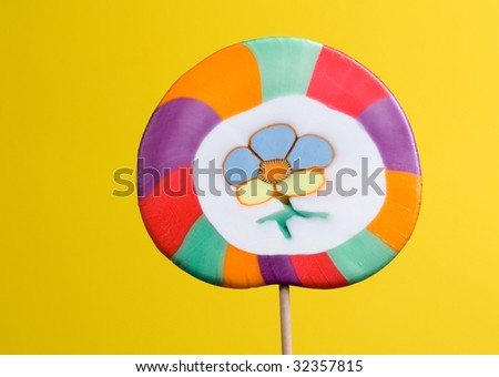 colorful lollipop over yellow background - stock photo