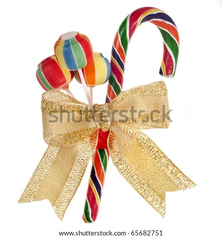 colorful lollipop with golden ribbon bow isolated on white - stock photo