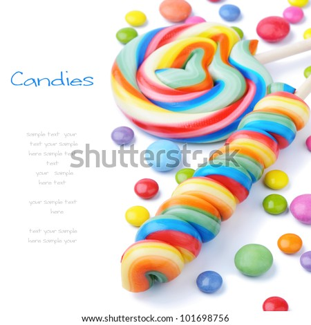 Colorful lollipops and smarties isolated on white - stock photo