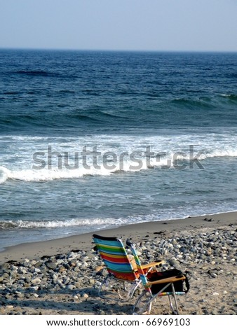 Colorful Lounge Chair on Rocky Beach - stock photo