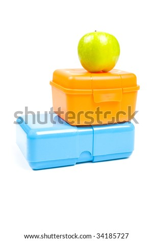 colorful lunchboxes with green apple isolated on white background - stock photo