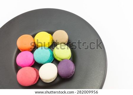 Colorful macaron in black plate on white background.