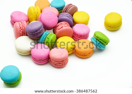 Colorful macaron in white plate.